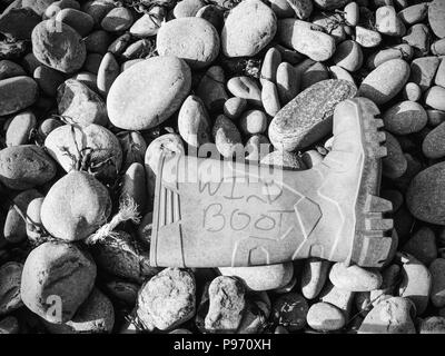 Dangerous garbage ejected from the sea on remote beaches. Environmental contamination with toxic mess. - Stock Photo