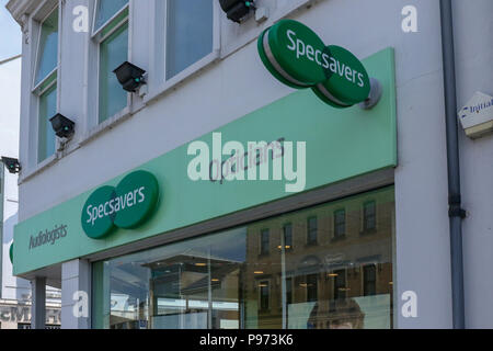Front of Specsavers opticians shop on the corner of a town centre main street. - Stock Photo
