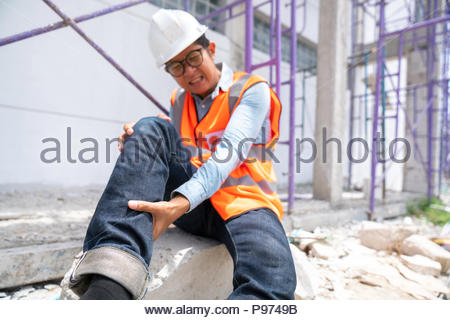 Construction worker has an accident while working - Stock Photo