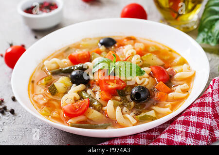 Minestrone, italian vegetable soup with pasta. Vegan food - Stock Photo