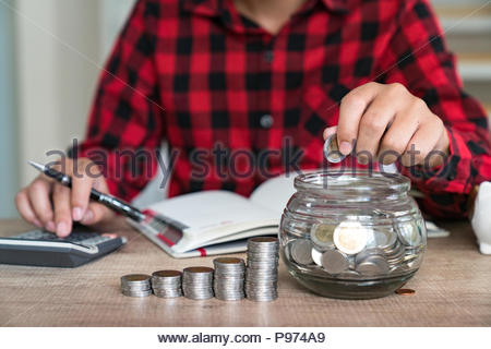 Saving money concept Man hand putting Row and coin Write Finance - Stock Photo