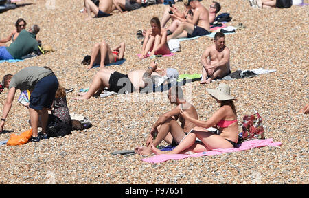 Brighton UK 15th July 2018 - Brighton beach is packed with sunbathers as the temperatures soar into the low 30s in some parts of the South East of Britain today Credit: Simon Dack/Alamy Live News - Stock Photo