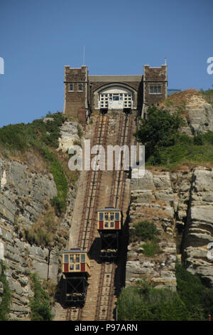 Hastings, UK -July 14 2018: The ast Hill Cliff Railway seen from the beach of the fishing port of Hastings on a hot summers day as the temperatures sore to above 27 degrees on 14 July 2018.  Hastings on the south coast of England is 53 miles south-east of London and is 8 miles from where the  Battle of Hastings took place in October 1066. Credit: David Mbiyu Credit: david mbiyu/Alamy Live News - Stock Photo