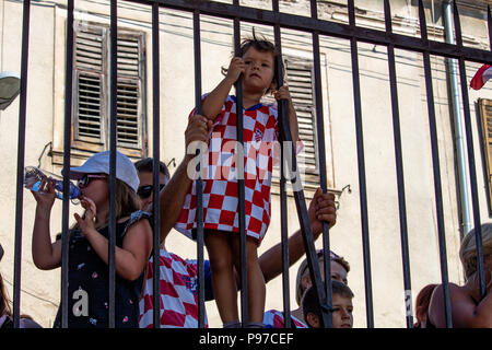 Pula, Croatia - July 15, 2018: Young croatian fan watching the final of the Football World Cup 2018 in Moscow on a jumbo screen in Pula's roman amphiteatre Credit: Dino Geromella/Alamy Live News