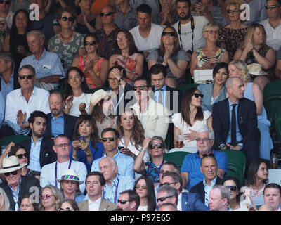 London, UK. 15th July 2018. John Vosler, Emma Watson and Luke Evans attend the men's singles final on day thirteen of the Wimbledon Tennis Championships at the All England Lawn Tennis and Croquet Club on July 15, 2018 in London, England.  People:  John Vosler, Emma Watson and Luke Evans Credit: Storms Media Group/Alamy Live News - Stock Photo