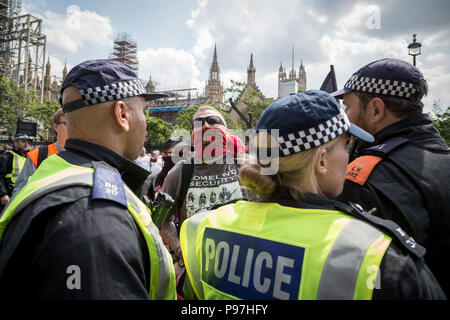 London, UK. 14th July 2018. Anti-fascist protesters clash with right-wing pro-Trump, 'Free Tommy Robinson' supporters and police in Westminster as Donald Trump visits London. Credit: Guy Corbishley/Alamy Live News - Stock Photo