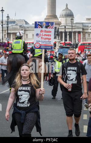 London, UK. 14th July 2018. Thousands of pro-Trump supporters join with 'Free Tommy Robinson' protesters to rally in Whitehall. Credit: Guy Corbishley/Alamy Live News - Stock Photo