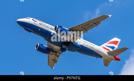 Berlin, Germany, 15.07.2018: British Airways Airbus A319 aircraft flying in the sky, Tegel Airport - Stock Photo