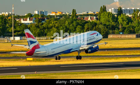 Berlin, Germany, 01.07.2018: British Airways Airbus A320 aircraft flying out of Tegel Airport - Stock Photo