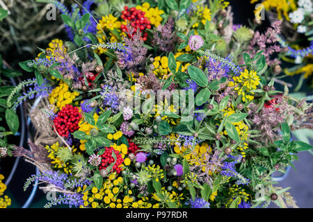 Bright mix bouquet of wild meadow flowers, natural bright colorful background - Stock Photo
