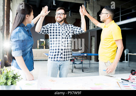 Creative Business Team High Five in Office - Stock Photo