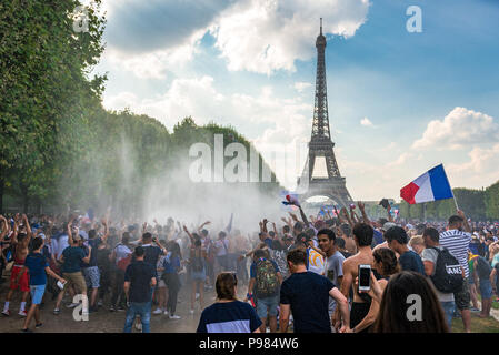 Firemen hose the crowd with water on the Champ de Mars in Paris as France wins the World Cup. Paris, France. - Stock Photo