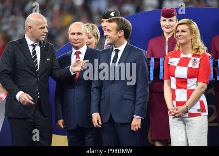 Moscow, Russland. 15th July, 2018. From: Gianni INFANTINO (FIFA President), Vladimir PUTIN (President Russia), Emmanuel MACRON (President of France), Kolinda Grabar-Kitarovic (President of Croatia). Award Ceremony, Victory Ceremony. France (FRA) - Croatia (CRO) 4-2, Final, Game 64, on 15.07.2018 in Moscow; Luzhniki Stadium. Football World Cup 2018 in Russia from 14.06. - 15.07.2018. | usage worldwide Credit: dpa/Alamy Live News - Stock Photo