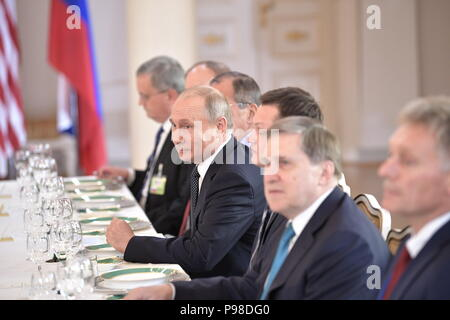 Helsinki, Finland. 16th July, 2018. HELSINKI, FINLAND - JULY 16, 2018: Russia's President Vladimir Putin (C) during an expanded meeting with US President Donald Trump. Mikhail Metzel/TASS Credit: ITAR-TASS News Agency/Alamy Live News - Stock Photo