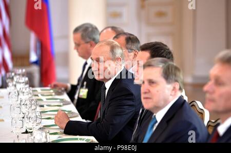 Helsinki, Finland. 16th July 2018. Russian President Vladimir Putin sits across from U.S. President Donald Trump during the full delegation meeting at the U.S. - Russia Summit Meeting at the Presidential Palace July 16, 2018 in Helsinki, Finland. Credit: Planetpix/Alamy Live News - Stock Photo