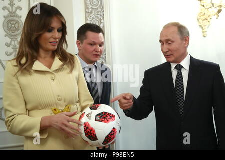 Helsinki, Finland. 16th July, 2018. HELSINKI, FINLAND - JULY 16, 2018: US First Lady Melania Trump (L) and Russia's President Vladimir Putin (R) after a news conference at the Presidential Palace. Valery Sharifulin/TASS Credit: ITAR-TASS News Agency/Alamy Live News - Stock Photo