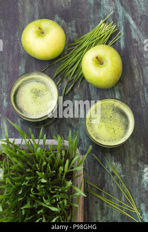 Detox. Fresh drink made from wheat grass and green apple - Stock Photo