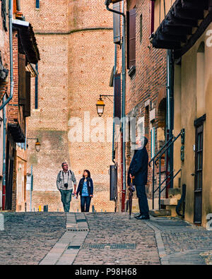 Tourists wander the medieval streets of the UNESCO listed Episcopal City of Albi, France - Stock Photo