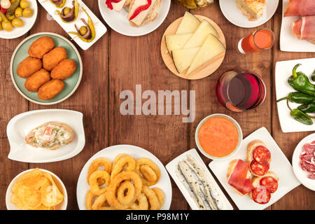 The food of Spain. Overhead photo of many different Spanish tapas with wine and copy space - Stock Photo