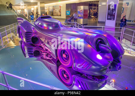 Bathed in purple lighting, this Batmobile from Tim Burton's 1989 film Batman now resides in the Smithsonian's National Museum of Ameican History in Wa - Stock Photo