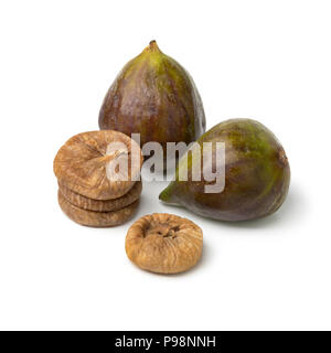 Fresh ripe figs and a heap of dried ones isolated on white background - Stock Photo