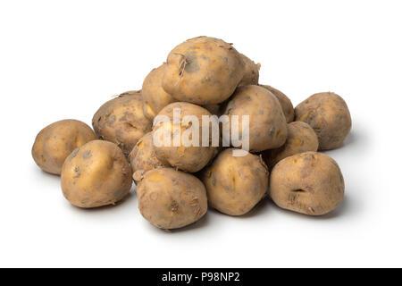 Heap of organic Dutch Opperdoezer ronde potatoes isolated on white background - Stock Photo