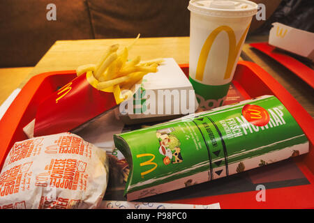 a meal of burgers, fries and a wrap served at McDonald's in Sarajevo, Bosnia and Herzegovina - Stock Photo
