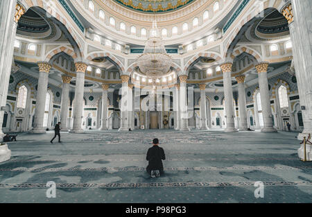 Muslim Prayer in Hazrat Sultan Mosque inside prayer room Astana Kazakhstan - Stock Photo