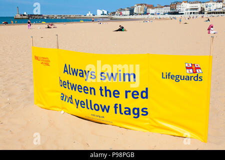 RNLI Lifeguards safe swimming sign on beach at Margate, Kent, UK, summer. - Stock Photo