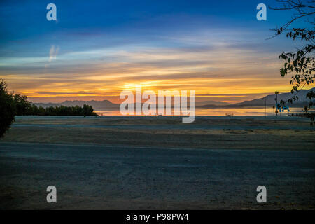 Dramatic vibrant sunset scenery in Lake Elsinore, California - Stock Photo