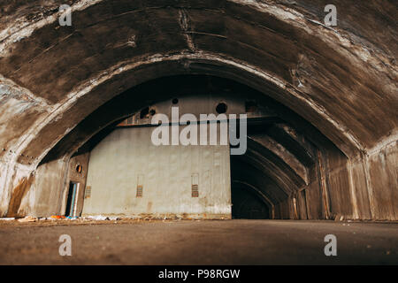 an abandoned aircraft hangar in the mountainside at Mostar Airport, Bosnia and Herzegovina - Stock Photo