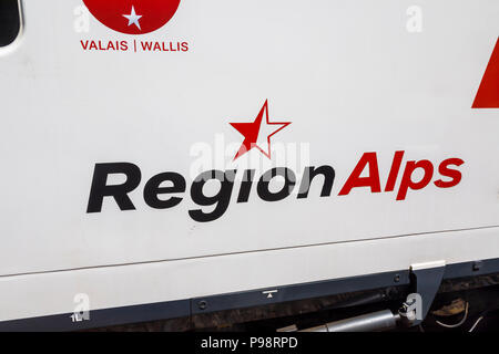 Region Alps logo on the exterior side of a railway carriage between Visp and Zermatt in the Valais region of southerwestern Switzerland - Stock Photo