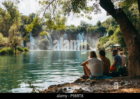 Kravica waterfall - a tufa cascade in Bosnia and Herzegovina, attracts many tourists for a refreshing dip to escape the summer heat - Stock Photo
