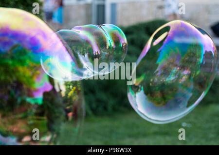 big soap bubbles in the garden - Stock Photo
