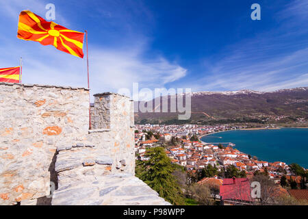 Ohrid, Republic of Macedonia : Macedonian flags on top of Samuel's Fortress and overview of the Unesco listed Ohrid old town and Ohrid lake. Built on  - Stock Photo