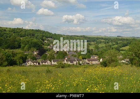 The English village of Parwich in summer with meadow flowers on the hills.  Parwich is located in the Peak District, in the county of Derbyshire. - Stock Photo