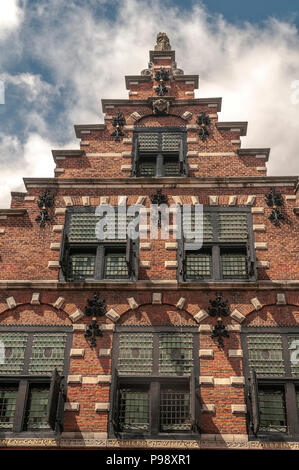medieval façade with small windows and wooden shutters in the city of Haarlem Netherlands - Stock Photo