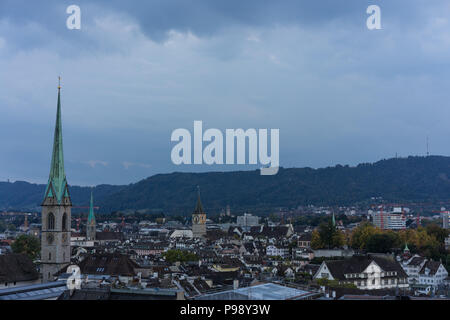 Zurich, Switzerland City Panorama at evening sunset with old town church view - Stock Photo