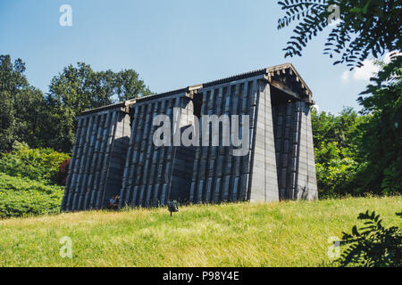 the dark concrete slabs of the Yugoslav-era Mausoleum of Struggle and Victory, Čačak, Serbia - Stock Photo