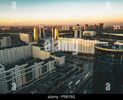 Sunset view towards Bayterek tower and hous of ministries in Astana Kazakhstan on a clear day - Stock Photo
