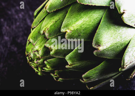ARTICHOKE. Close up of artichoke, top view, dark background. Macro - Stock Photo