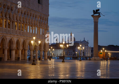 San Marco square with lion on column and San Giorgio Maggiore basilica nobody before sunrise in Venice, Italy - Stock Photo