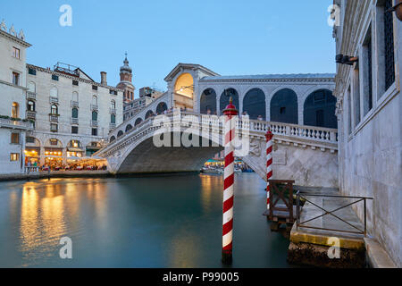 The Grand Canal and Rialto bridge with people, evening in Venice, Italy - Stock Photo