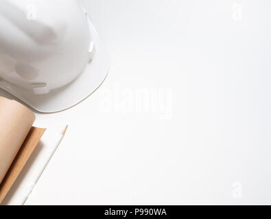 flat lay white hard Safety helmet with paper and pencil for engineering worker isolated on white background top view with space. - Stock Photo