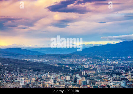 Aerial panoramic view of Tbilisi city at sunset, Georgia country, Europe - Stock Photo
