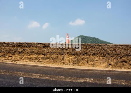 Layers soil and rock of traffic road Layer soil paving Layer of crush rock - Stock Photo