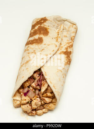 Pita bread filled with stir-fried chicken - Stock Photo