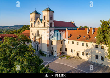 Benedictine abbey, monastery and Saint Peter and Paul church in Tyniec near Krakow, Poland. Aerial view at sunset - Stock Photo
