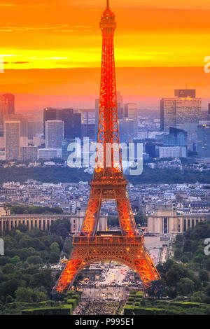 Paris, France - June 30, 2017:Closeup of Tour Eiffel in sunset sky from panoramic terrace of Tour Montparnasse. French capital. Aerial view of Paris skyline, popular travel destination. Vertical. - Stock Photo