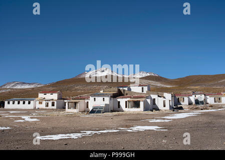 The wintery landscape of Laguna Cañapa (Cañapa salt lake) and its small group of white houses. Potosí Department, Bolivia. - Stock Photo